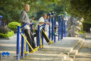 Elderly men exercise at a public outdoor park in Yangshuo, China.